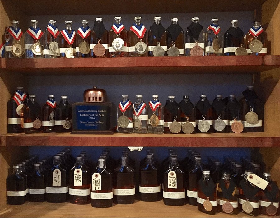 A collection of Kings County Distillery's medals for their award winning whiskies