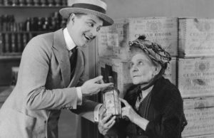Old-timey bootlegger selling a grandma some suspect gin