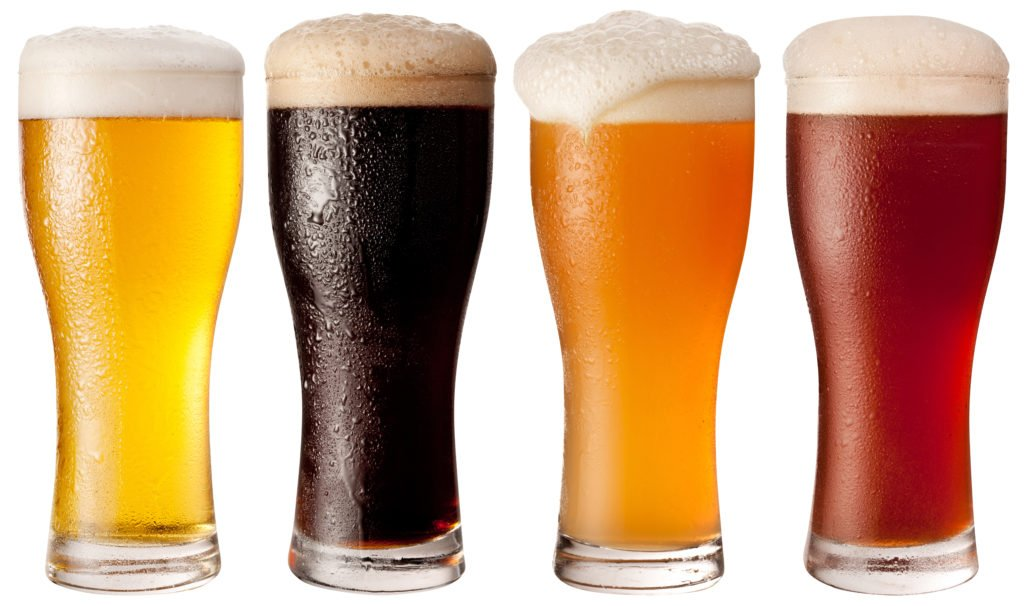 Four glasses with different sour beers foamy, frothy and ready to drink