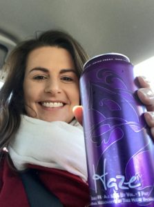 Suz holding a can of The famed TreeHouse beer