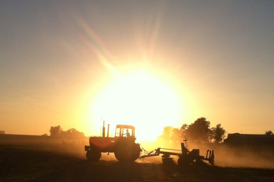 A Tractor Planting Wheat in the Illinois Sunset