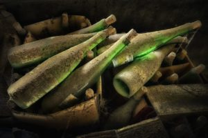 Old wine bottles covered in dirt