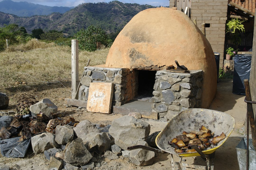 Agave, the plant base for Mezcal, is split and roasted for three days in a traditional agave oven.