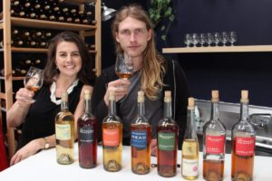 Suzanne and John of The Meadery posing with their lineup of bottles