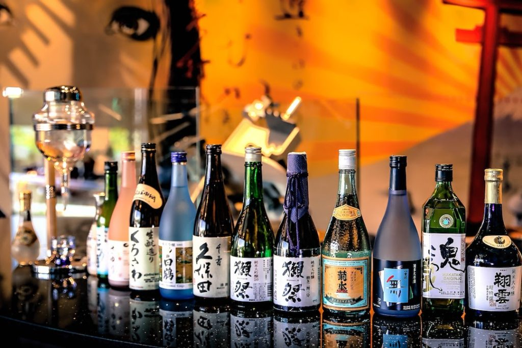 Line Up of Sake Bottles in A Japanese Bar