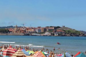 View of the city from Gijon Beach during an air show