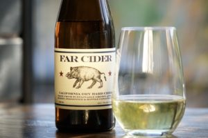 Bottle of Far Cider with a glass