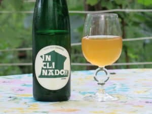 Tilted Shed's Sidra Inclinado bottle with a glass of cider next to it