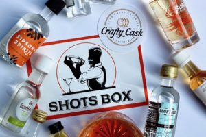 9 mini bottles and one drink scattered on a white background with the Shots Box and Crafty Cask logos