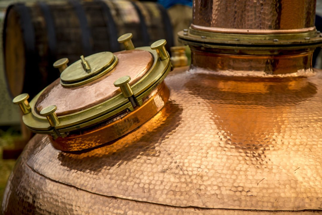 Close up of a copper pot still