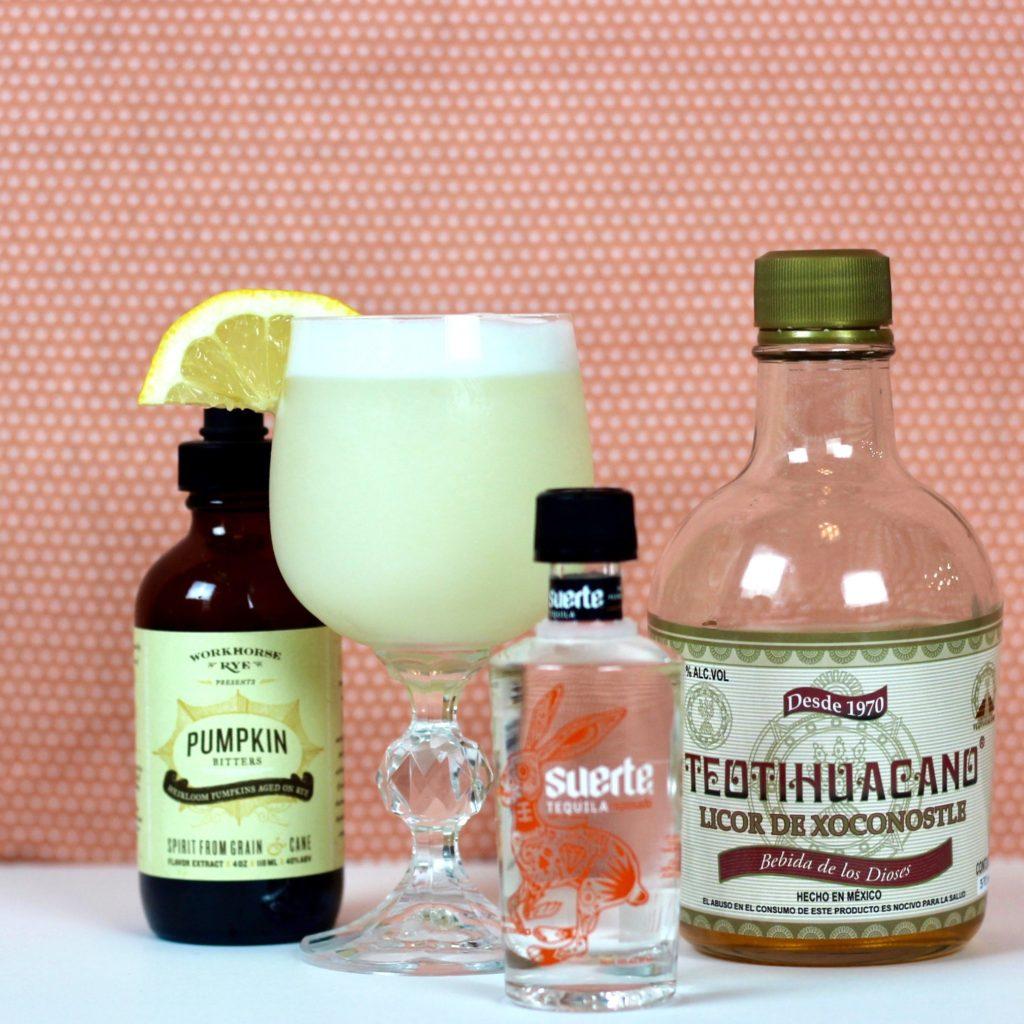 Image of Prickly Pear Flip Cocktail with ingredients/bottles displayed