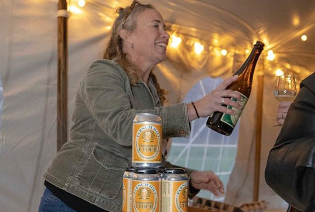 Cider maker pouring at the Tasting Salon