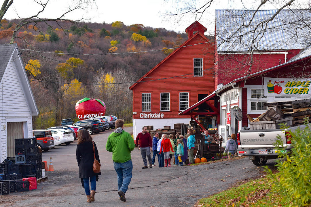 Suz and cidermaking friend, Gordon, walking towards the big red barn of Clarkdale Farms