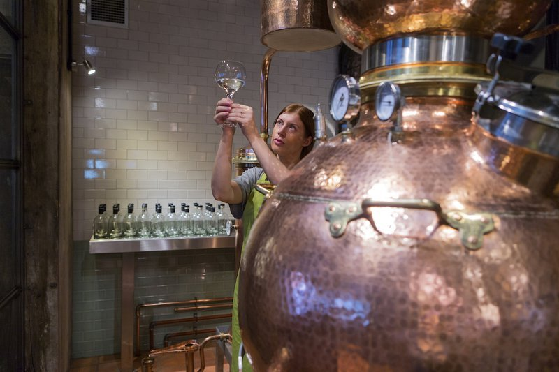 Female Distiller at an Alembic Pot Still