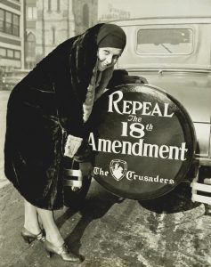 Repeal the 18th Amendment' slogan on a spare tire cover. Dec. 16, 1930. Miss Elizabeth Thompson, was a member of 'The Crusaders', a national organization formed to overthrow prohibition