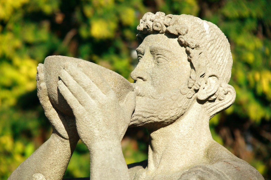 Ancient Roman Statue Taking a Sip