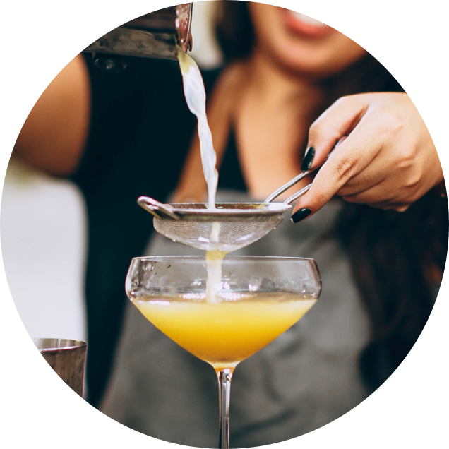 Woman pouring a cocktail