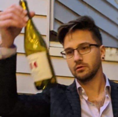 Portrait of Stefan with wine bottle
