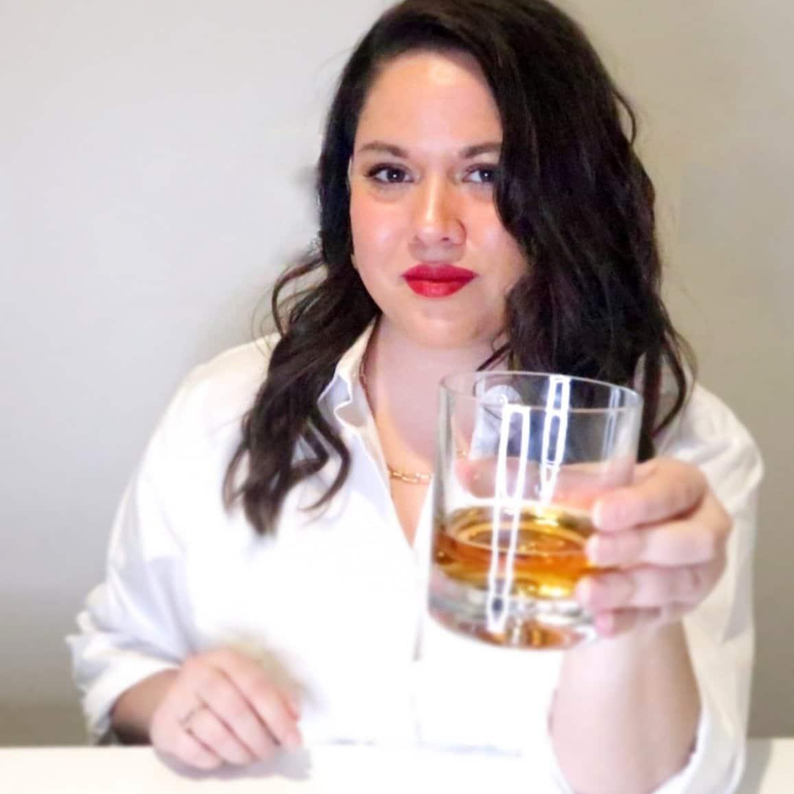 Heather holding a beer stein